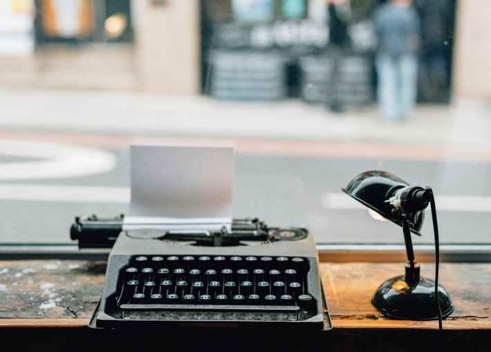 lamp beside typewriter